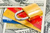 Credit cards, money and lock - business security background