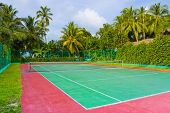 Tennis court on a tropical island - sport background