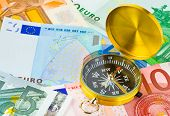 Compass and euro money - business background