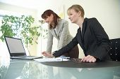 foto of human resource management  - two businesswomen are discussing the work - JPG