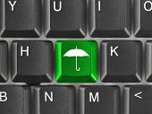 Computer keyboard with umbrella key - technology background