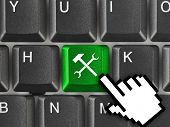 Computer keyboard with tools key - technology background