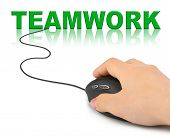 Hand with computer mouse and word Teamwork - business concept