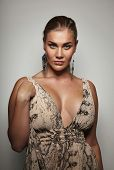 stock photo of plus size model  - Portrait of sensual female model in formal dress posing to camera - JPG