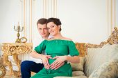 Cute Young Couple Embracing Tenderly Pregnant Tummy.