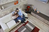 picture of youg  - happy youg family relaxing in modern livingroom at home - JPG