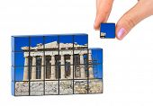 Hand and Parthenon (my photo) puzzle isolated on white background