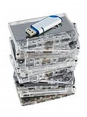 Stack of audio cassettes and flash memory isolated on white background