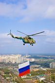 Helicopter with russian flag over Moscow at parade of victory day - aerial view