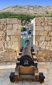Retro cannon at Dubrovnik, Croatia - architecture background