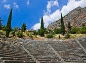 Ruins of amphitheater in Delphi, Greece - archaeology background