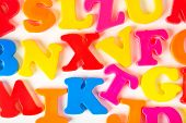 Multicolored toy letters - abstract education background