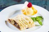 Apple Strudel With Icing Sugar,almonds And Vanilla Ice Cream