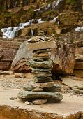 Tvinde fossen Waterfall and stones stack - Norway - nature and travel background