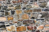 Wall of stones - construction background