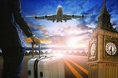 pic of air transport  - business man and luggage standing in airport and passenger jet plane flying over runway against beautiful sky use for air transport and travel by airline topic - JPG