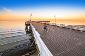Sunrise at wooden pier in Sopot, Poland