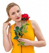 charming young woman with a flower and thinking about love