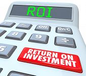 picture of subtraction  - ROI and Return on Investment Words on a calculator display and its buttons to figure the costs and profits in investing in stocks - JPG