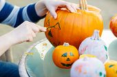 Hollowing Out A Pumpkin To Prepare Halloween Lantern