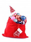 Red bag with Christmas toys isolated on white