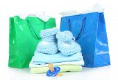 Baby clothes and gift bags isolated on white
