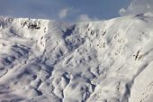 View On Off-piste Snowy Slope At Evening