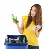 Young girl sorting glass bottles isolated on white