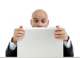 picture of spanish money  - excited desperate businessman in stress at computer laptop holding monitor watching online finances drop down or loosing money online gambling isolated on white background - JPG