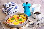 foto of quail egg  - Fried  eggs of quail eggs with vegetables in a pan - JPG