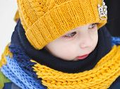 image of little boys only  - little boy on a walk in the winter yellow cap