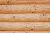 picture of log fence  - light shade horizontal background wood texture of logs - JPG