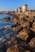 pic of windmills  - Mandraki Harbour windmills on the Island of Rhodes Greece - JPG