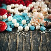 foto of beads  - Different Colorful Beads on wooden background - JPG