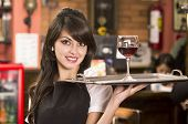 stock photo of serving tray  - beautiful young waitress girl serving a drink holding tray - JPG