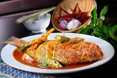 stock photo of red snapper  - Red snapper cook with spicy sambal with nice background - JPG
