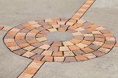 foto of paving stone  - Patterned paving tiles Red brick stone floor background - JPG