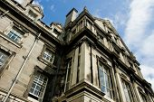 stock photo of trinity  - Part of building at Trinity college university campus in Dublin Ireland view from the ground in sunny day - JPG