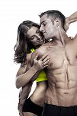 picture of nude couple  - sexy couple muscular man holding a beautiful woman isolated on a white background - JPG