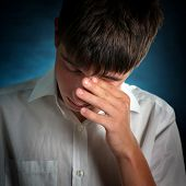 pic of sorrow  - Sorrowful Young Man on the Dark Background - JPG