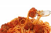 stock photo of meatballs  - Closeup of spaghetti and meatballs on a fork against a white background - JPG