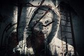 picture of horror  - Abstract monochrome horror background abandoned dark room with ghost of dangerous man in hood - JPG
