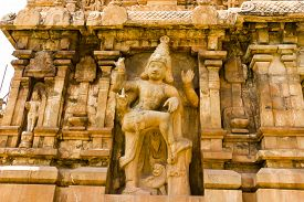 stock photo of gatekeeper  - Magnaficient Image of left side gatekeeper engraved on entrance gopuram or tower of Brahadeewarar temple - JPG