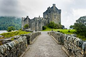 picture of cloudy  - View of Eileen Donan Castle Scotland in cloudy day with dramatic light - JPG