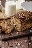 stock photo of whole-wheat  - Whole wheat bread baked at home bio ingredients very healthy with seeds - JPG