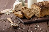 foto of whole-wheat  - Whole wheat bread baked at home bio ingredients very healthy with seeds - JPG