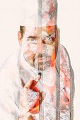picture of nod  - double exposure of a male chef showing a ok sign with coals on a grill on background - JPG