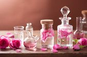 pic of flask  - alchemy and aromatherapy set with rose flowers and flasks - JPG