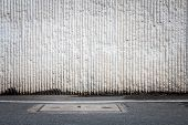 picture of manhole  - Concrete wall and asphaltic road with manhole traffic background - JPG