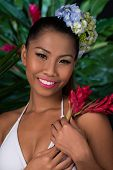 image of filipina  - Pretty Filipina with red ginger flower looking at the camera - JPG